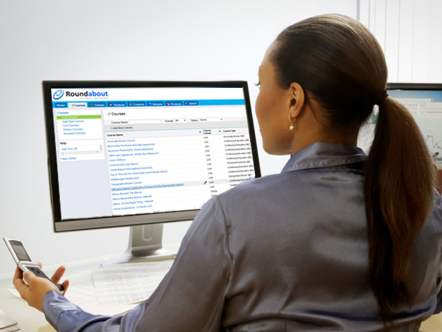 Woman at computer ponytail